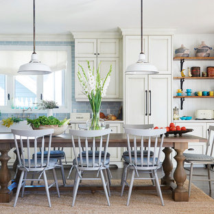 Inspiration for a large beach style dark wood floor and brown floor eat-in kitchen remodel in Toronto with a farmhouse sink, white cabinets, quartz countertops, blue backsplash, paneled appliances, recessed-panel cabinets, subway tile backsplash and no island
