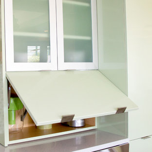 Design ideas for a medium sized contemporary l-shaped open plan kitchen in Miami with flat-panel cabinets, green cabinets, multi-coloured splashback, mosaic tiled splashback, stainless steel appliances, an island and quartz worktops.
