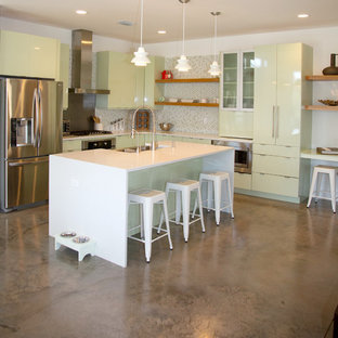 Inspiration for a medium sized contemporary l-shaped open plan kitchen in Miami with flat-panel cabinets, green cabinets, multi-coloured splashback, mosaic tiled splashback, stainless steel appliances, an island, a belfast sink and quartz worktops.