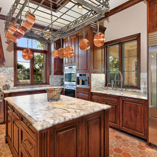 Design ideas for a transitional eat-in kitchen in Orange County with an undermount sink, raised-panel cabinets, dark wood cabinets, dark hardwood floors, multiple islands, red floor and brown benchtop.