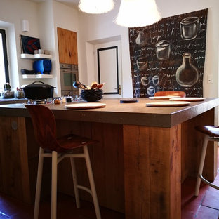Photo of a small country l-shaped open plan kitchen in Other with an integrated sink, light wood cabinets, granite benchtops, stainless steel appliances, terra-cotta floors, with island, pink floor and grey benchtop.