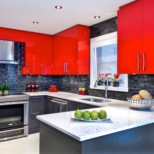 Trendy u-shaped kitchen photo in Montreal with a double-bowl sink, flat-panel cabinets, red cabinets, black backsplash, matchstick tile backsplash and stainless steel appliances