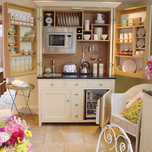 Design ideas for a traditional kitchen in London with open cabinets and white cabinets.