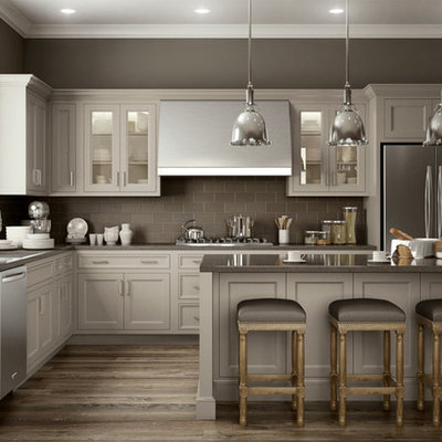 Mid-sized minimalist l-shaped medium tone wood floor and brown floor kitchen photo in Other with an undermount sink, recessed-panel cabinets, gray cabinets, quartz countertops, gray backsplash, porcelain backsplash, stainless steel appliances, an island and gray countertops
