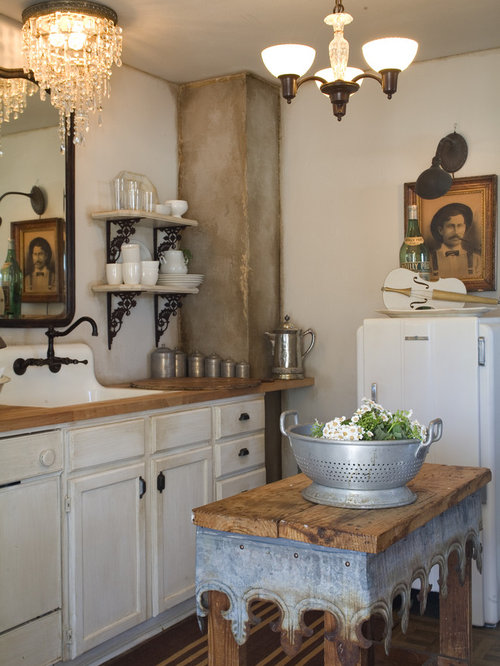 Example Of A Cottage Chic Kitchen Design In Other With Wood Countertops,  White Cabinets,