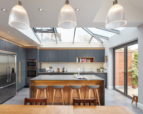 Large Modern L Shaped Kitchen/diner In London With A Submerged Sink, Flat