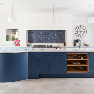 Large transitional kitchen in Cardiff with shaker cabinets, blue cabinets, quartzite benchtops, blue splashback, mosaic tile splashback, limestone floors, with island and beige floor.