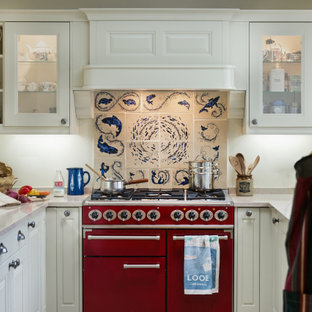 Inspiration for a small classic u-shaped kitchen in Cornwall with quartz worktops, ceramic splashback, coloured appliances, beige worktops, raised-panel cabinets, white cabinets, multi-coloured splashback and no island.