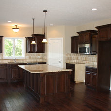 Traditional Kitchen by American Heritage Homes