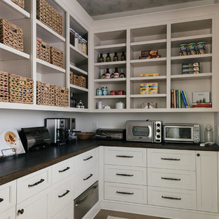 Large transitional kitchen pantry ideas - Example of a large transitional l-shaped light wood floor and brown floor kitchen pantry design in Atlanta with shaker cabinets, white cabinets, wood countertops, white backsplash, stainless steel appliances and no island