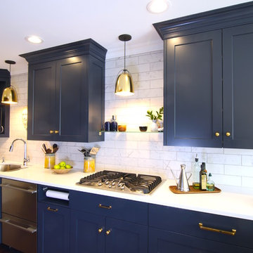 Custom Blue Cabinetry in Modern Galley kitchen