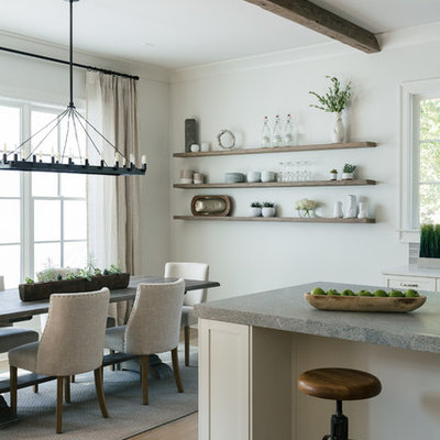 Eat-in kitchen - large transitional l-shaped light wood floor and brown floor eat-in kitchen idea in Atlanta with an island, an undermount sink, shaker cabinets, white cabinets, gray backsplash, porcelain backsplash, stainless steel appliances and limestone countertops