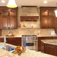 Eclectic Kitchen by Otero Signature Homes