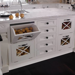 Design ideas for a medium sized rustic u-shaped kitchen pantry in Houston with a single-bowl sink, beaded cabinets, white cabinets, composite countertops, multi-coloured splashback, ceramic splashback, stainless steel appliances, dark hardwood flooring and an island.
