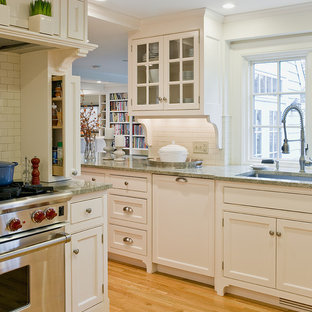 This is an example of a traditional kitchen in Boston with beaded inset cabinets, beige cabinets and green benchtop.