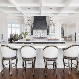 Inspiration for a separate kitchen in St Louis with an undermount sink, shaker cabinets, white cabinets, multi-coloured splashback, medium hardwood floors, multiple islands, white benchtop and coffered.