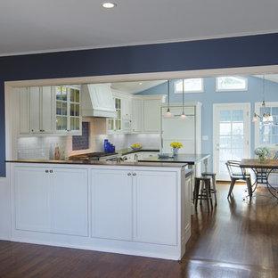 Shabby-chic style kitchen in San Diego with white cabinets, white splashback, subway tile splashback, stainless steel appliances, medium hardwood floors and with island.