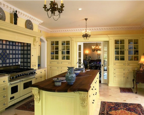 example of a classic enclosed kitchen design in bridgeport with yellow cabinets wood countertops - Kitchen Design In Yellow