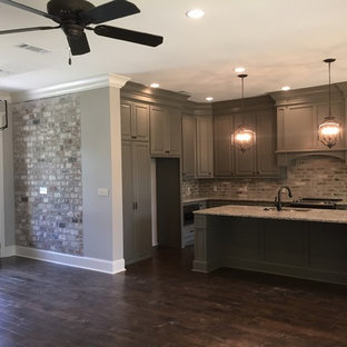 Inspiration for an arts and crafts l-shaped eat-in kitchen in Other with a double-bowl sink, raised-panel cabinets, grey cabinets, granite benchtops, grey splashback, brick splashback, stainless steel appliances, dark hardwood floors and with island.