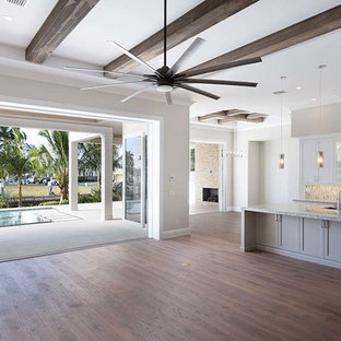 Mid-sized contemporary open concept kitchen remodeling - Inspiration for a mid-sized contemporary single-wall open concept kitchen remodel in Other with an island