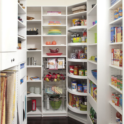 Example of a mid-sized classic dark wood floor kitchen pantry design in Philadelphia with open cabinets and white cabinets