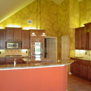 Southwestern kitchen ideas - Example of a southwest kitchen design in Dallas