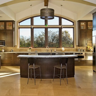 Contemporary kitchen pictures - Example of a trendy kitchen design in Nashville with recessed-panel cabinets, dark wood cabinets and beige backsplash
