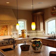 Mediterranean Kitchen by Phoenix Contractors, Inc.