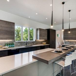 Large contemporary u-shaped open plan kitchen in Denver with an undermount sink, flat-panel cabinets, quartz benchtops, metallic splashback, metal splashback, stainless steel appliances, porcelain floors, multiple islands and grey floor.