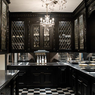 Mid-sized eclectic l-shaped kitchen in Cleveland with glass-front cabinets, black cabinets, marble floors, an undermount sink, mirror splashback, no island, multi-coloured floor and panelled appliances.