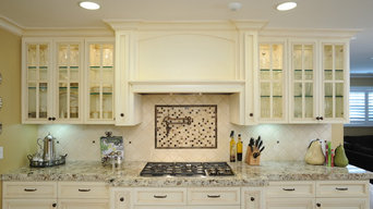 Custom hood and glass-front cabinets