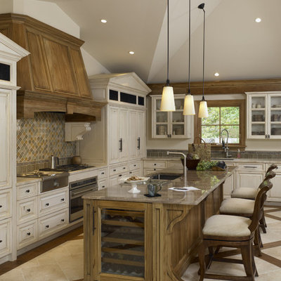 Inspiration for a timeless kitchen remodel in Chicago with glass-front cabinets and paneled appliances