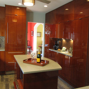 This is an example of a mid-sized contemporary u-shaped separate kitchen in New York with an undermount sink, flat-panel cabinets, brown cabinets, quartz benchtops, metallic splashback, metal splashback, panelled appliances, slate floors, with island, green floor and green benchtop.