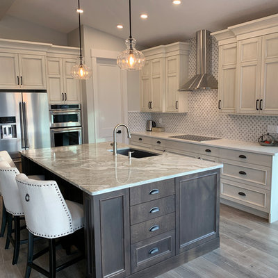 Inspiration for a large timeless l-shaped laminate floor and gray floor eat-in kitchen remodel in Calgary with an undermount sink, recessed-panel cabinets, distressed cabinets, quartz countertops, white backsplash, marble backsplash, stainless steel appliances, an island and white countertops