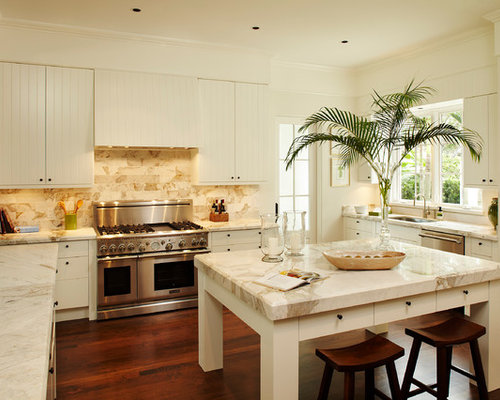 Mid Sized Elegant U Shaped Kitchen Photo In Miami With Stainless Steel  Appliances,
