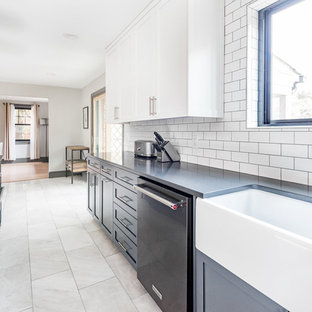 Large farmhouse enclosed kitchen designs - Example of a large cottage l-shaped marble floor and gray floor enclosed kitchen design in Richmond with a farmhouse sink, shaker cabinets, blue cabinets, quartz countertops, white backsplash, subway tile backsplash, black appliances, an island and black countertops