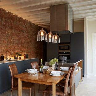 Mid-sized contemporary eat-in kitchen pictures - Eat-in kitchen - mid-sized contemporary light wood floor and exposed beam eat-in kitchen idea in London with stainless steel appliances and an island