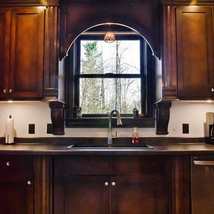 Design ideas for a large classic l-shaped kitchen/diner in Other with recessed-panel cabinets, dark wood cabinets, granite worktops, stainless steel appliances, ceramic flooring, an island and white floors.