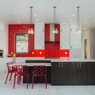 Huge contemporary kitchen remodeling - Inspiration for a huge contemporary beige floor kitchen remodel in Denver with flat-panel cabinets, white cabinets, quartzite countertops, red backsplash, subway tile backsplash, stainless steel appliances, white countertops, a farmhouse sink and an island