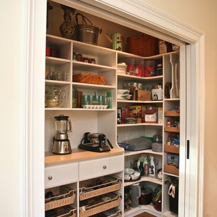 Traditional kitchen pantry remodeling - Elegant kitchen pantry photo in Boston with white cabinets and open cabinets