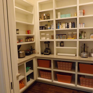 Inspiration for a mid-sized traditional kitchen pantry in Atlanta with white cabinets, medium hardwood floors, open cabinets and brown floor.