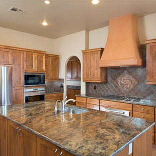 Inspiration for a southwestern ceramic tile kitchen remodel in Austin with ceramic backsplash, stainless steel appliances and an island
