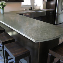 "Concrete Countertops - This is a concrete countertop that was installed in a Beach home In Belmar NJ.  The project was fabricated by Trueform Concrete.  The countertop was 1.5"" thick with an eased edge profile.  the color of the concrete was Taupe and it was done in a precast handtrowled finish.  The farm sink was stainless steel."