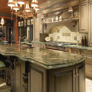 Design ideas for a large traditional single-wall eat-in kitchen in Miami with a farmhouse sink, raised-panel cabinets, beige cabinets, granite benchtops, multi-coloured splashback, porcelain splashback, travertine floors, with island, beige floor and green benchtop.