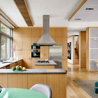 Large trendy u-shaped open concept kitchen photo in Austin with an undermount sink, flat-panel cabinets, light wood cabinets and stainless steel appliances