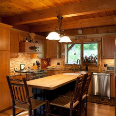 Rustic Kitchen by Woodhouse Post & Beam Homes