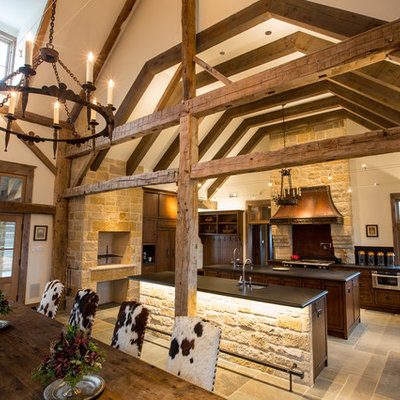 Example of a huge mountain style eat-in kitchen design in Dallas with dark wood cabinets