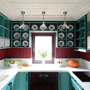 Farmhouse kitchen remodeling - Example of a farmhouse u-shaped kitchen design in Moscow with an integrated sink, shaker cabinets, green cabinets, red backsplash and no island