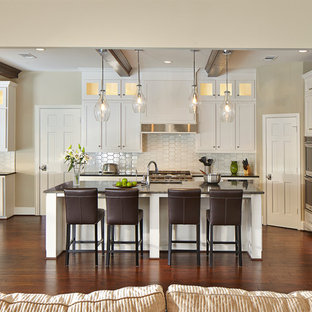 Eat-in kitchen - traditional u-shaped eat-in kitchen idea in Dallas with an undermount sink, shaker cabinets, white cabinets, granite countertops, white backsplash, ceramic backsplash and stainless steel appliances