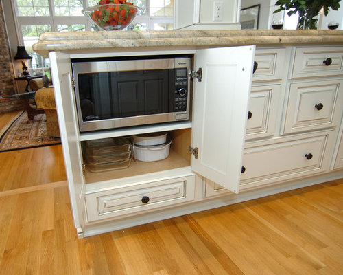 example of a classic galley open concept kitchen design in dallas with cabinets